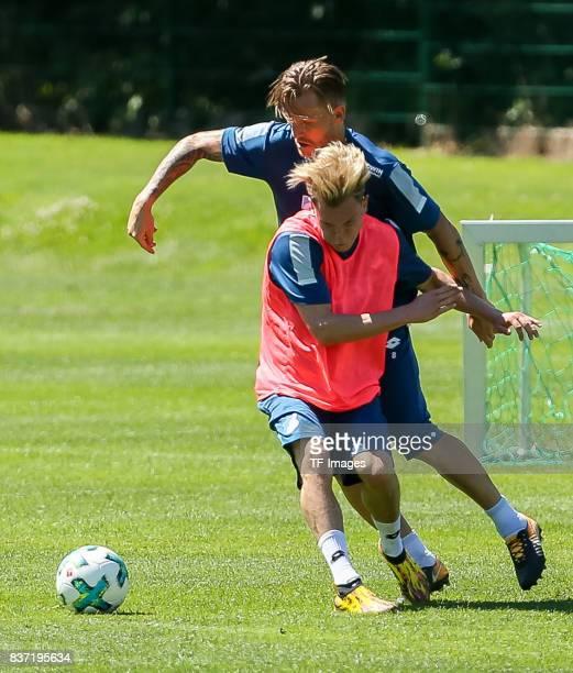 Robin Hack of Hoffenheim and Eugen Polanski of Hoffenheim battle for the ball during the Training Camp of TSG 1899 Hoffenheim on July 16 2017 in...