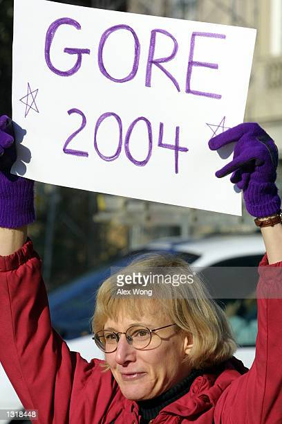 Robin Harr of Bethesda Maryland holds a banner to show her support for Democratic presidential candidate Vice President Al Gore December 13 2000...