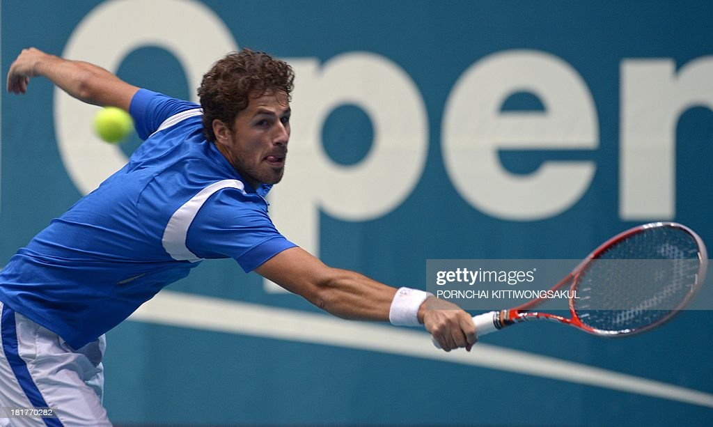 Robin Hasse of the Netherlands hits the ball as return to his compatriot Igor Sijsling during the second round of Tennis ATP Thailand Open 2013 tournament in Bangkok on September 25, 2013.