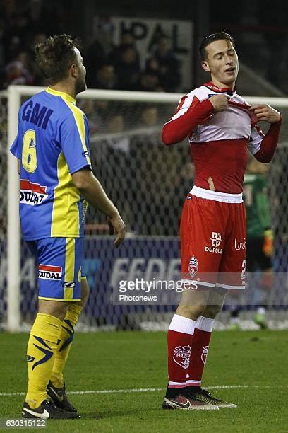 Robin Henkens midfielder of KVC Westerlo and Mergim Vojvoda defender of Royal Excel Mouscron looks dejected on the final whistle after the Jupiler...