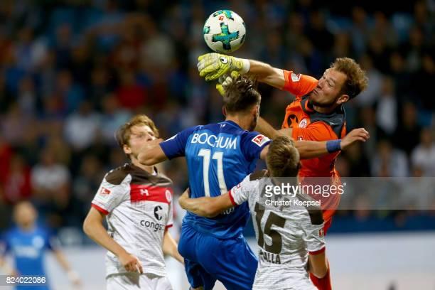 Robin Himmelmann of St Pauli saves the ball against Dimitrios Diamantakos of Bochum during the Second Bundesliga match between VfL Bochum 1848 and FC...