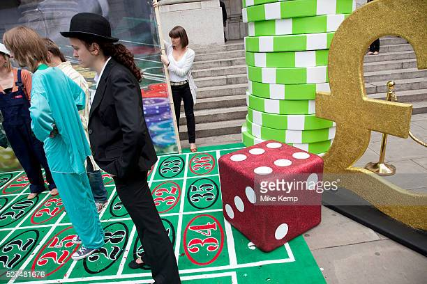 Robin Hood Tax supporters protest at the Royal Exchange near the Bank of England in the City of London Campaigners today set up a giant roulette...