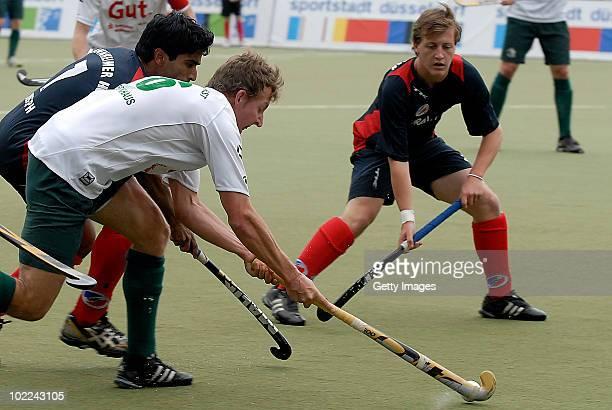 Robin Joseph of Mannheim battles for fhe hockey ball with Jan Fleckhaus of Muelheim during the men's 3rd/4th place match between Mannheimer HC and...