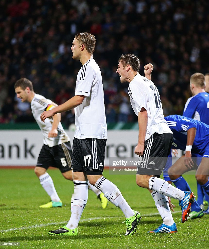 Robin Knoche of Germany (R) celebrates his team's first goal during the 2015 UEFA European U21 Championships Qualifying Group Six match between Germany U21 and Faroe Islands U21 at Auestadion on October 15, 2013 in Kassel, Germany.