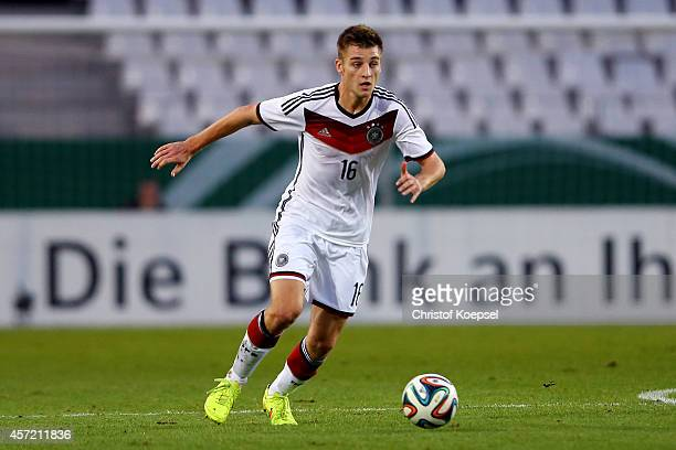 Robin Knoche of Germany runs with the ball during the UEFA U21 Championship Playoff second leg match between Germany and Ukraine at Stadion Essen on...