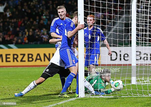 Robin Knoche of Germany scores his team's first goal against goalkeeper Teitur Gestson of Faroe Islands during the 2015 UEFA European U21...