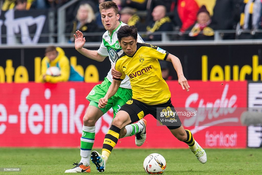 Robin Knoche of VFL Wolfsburg, Shinji Kagawa of Borussia Dortmund during the Bundesliga match between Borussia Dortmund and VfL Wolfsburg on April 30, 2016 at the Signal Idun Park stadium in Dortmund, Germany.