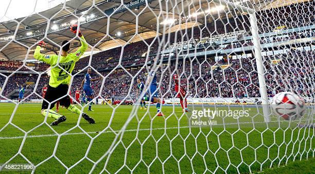 Robin Knoche of Wolfsburg celebrates after scoring his team's second goal during the Bundesliga match between VfB Stuttgart and VfL Wolfsburg at...