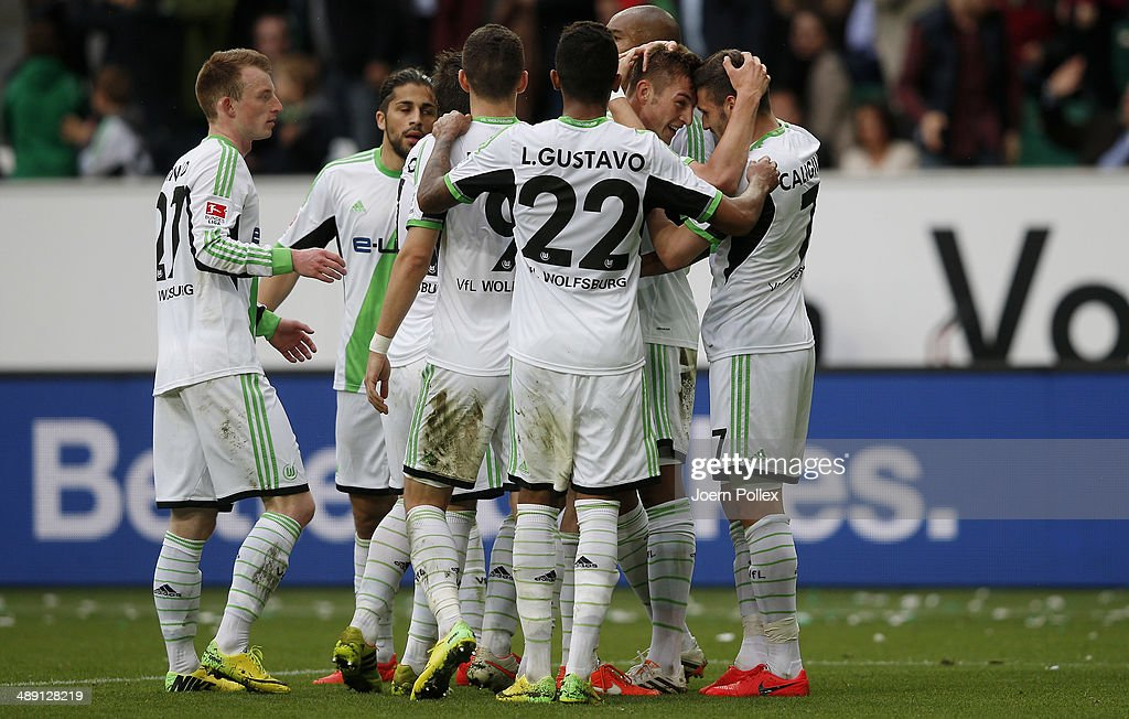 <a gi-track='captionPersonalityLinkClicked' href=/galleries/search?phrase=Robin+Knoche&family=editorial&specificpeople=5927293 ng-click='$event.stopPropagation()'>Robin Knoche</a> (2nd R) of Wolfsburg celebrates with his team mates after scoring his team's third goal during the Bundesliga match between at Volkswagen Arena on May 10, 2014 in Wolfsburg, Germany.