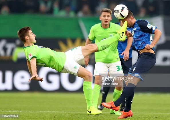 Robin Knoche of Wolfsburg challenges Marco Terrazzino of Wolfsburg during the Bundesliga match between VfL Wolfsburg and TSG 1899 Hoffenheim at...