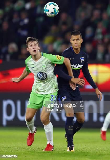 Robin Knoche of Wolfsburg is challenged by Davie Selke of Berlin during the Bundesliga match between VfL Wolfsburg and Hertha BSC at Volkswagen Arena...