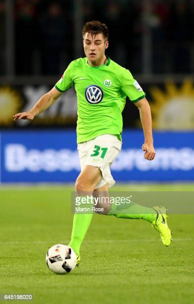 Robin Knoche of Wolfsburg runs with the ball during the Bundesliga match between VfL Wolfsburg and Werder Bremen at Volkswagen Arena on February 24...