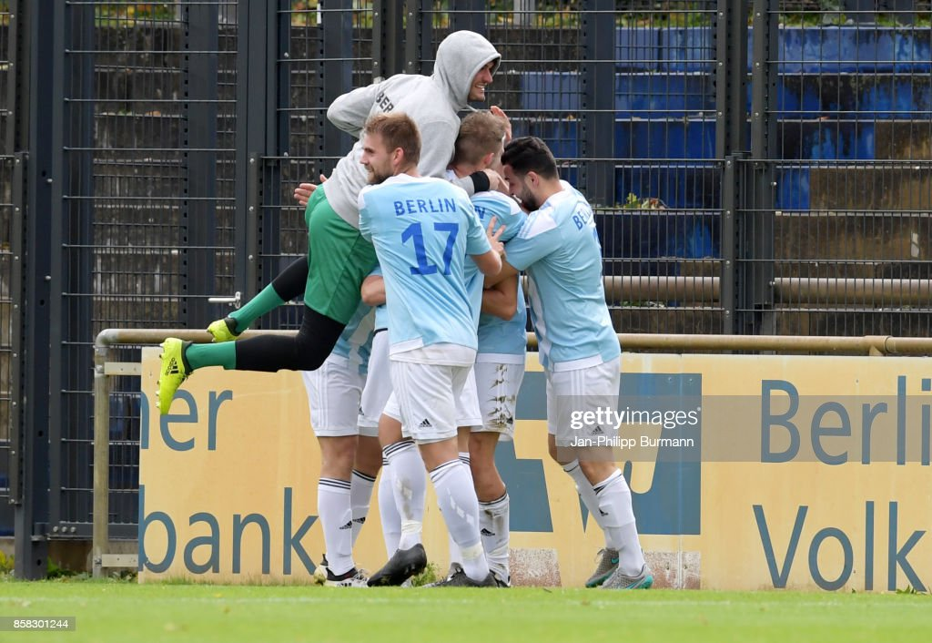 Robin Koller, Phillip Januschowsky, Marcus Uher and Eike Doht of the Polizeiauswahl celebrate after scoring the 0:1 during the test match between Hertha BSC and the Polizeiauswahl on october 6, 2017 in Berlin, Germany.