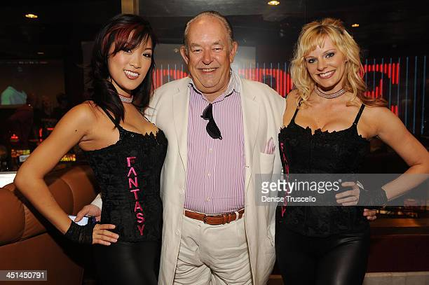 Robin Leach and the Fantacy girls attend the Brenden Celebrity Suites at The Palms Casino Resort on June 15 2009 in Las Vegas Nevada