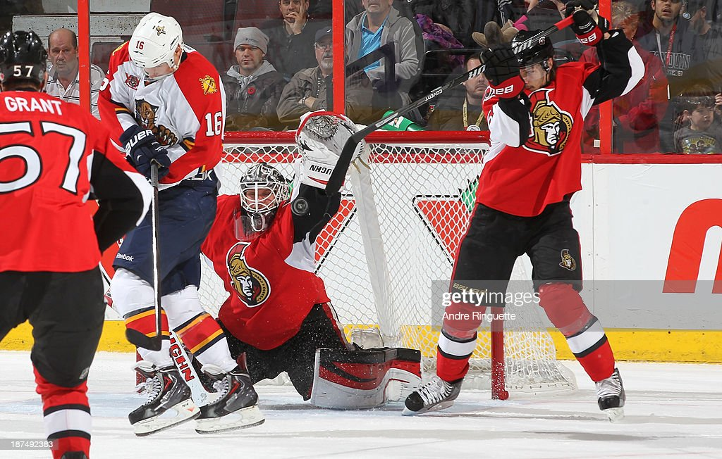 <a gi-track='captionPersonalityLinkClicked' href=/galleries/search?phrase=Robin+Lehner&family=editorial&specificpeople=5894610 ng-click='$event.stopPropagation()'>Robin Lehner</a> #40 and <a gi-track='captionPersonalityLinkClicked' href=/galleries/search?phrase=Erik+Karlsson&family=editorial&specificpeople=5370939 ng-click='$event.stopPropagation()'>Erik Karlsson</a> #65 of the Ottawa Senators block a shot as <a gi-track='captionPersonalityLinkClicked' href=/galleries/search?phrase=Aleksander+Barkov&family=editorial&specificpeople=8760147 ng-click='$event.stopPropagation()'>Aleksander Barkov</a> #16 of the Florida Panthers provides a screen in front of the crease at Canadian Tire Centre on November 9, 2013 in Ottawa, Ontario, Canada.
