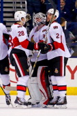 Robin Lehner is congratulated by Matt Kassian and Jared Cowen of the Ottawa Senators after defeating the Columbus Blue Jackets 41 on November 5 2013...