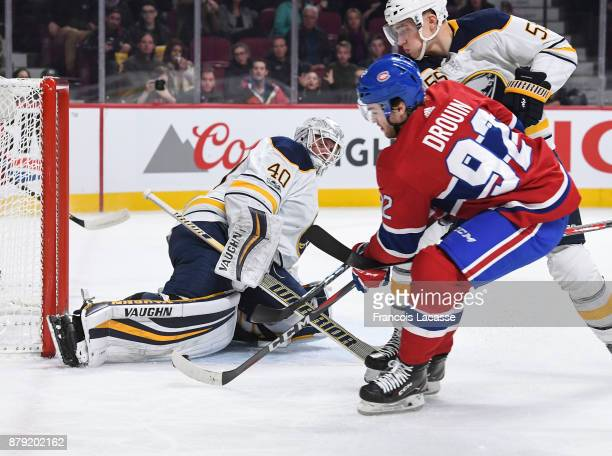 Robin Lehner of the Buffalo Sabres makes a kick save against Jonathan Drouin of the Montreal Canadiens in the NHL game at the Bell Centre on November...