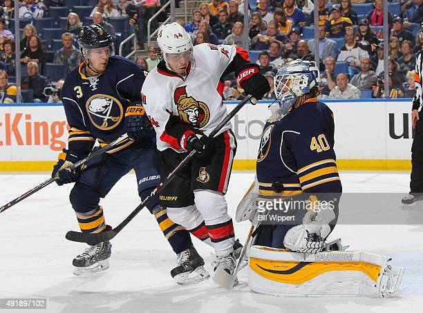 Robin Lehner of the Buffalo Sabres makes a second period save against JeanGabriel Pageau of the Ottawa Senators while being defended by Mark Pysyk on...