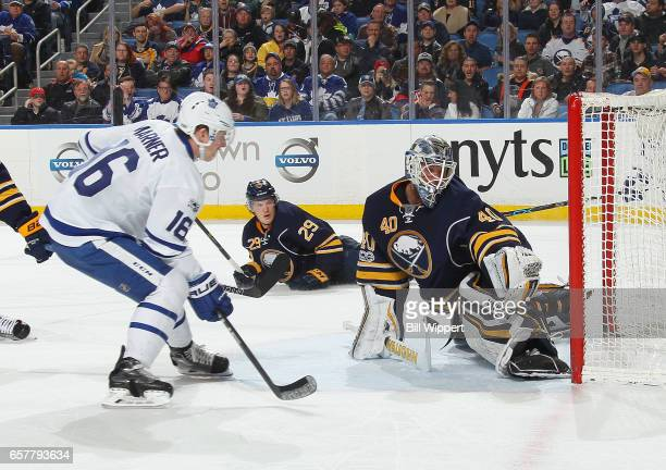 Robin Lehner of the Buffalo Sabres makes a second period save against Mitchell Marner of the Toronto Maple Leafs during an NHL game at the KeyBank...