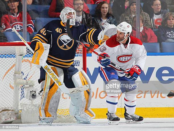 Robin Lehner of the Buffalo Sabres shoves Mike Brown of the Montreal Canadiens playing in his 400th NHL game during an NHL game on March 16 2016 at...