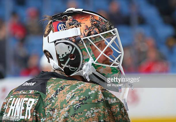 Robin Lehner of the Buffalo Sabres wears a camouflage warmup jersey and special mask on Military Appreciaton Night before an NHL game against the New...