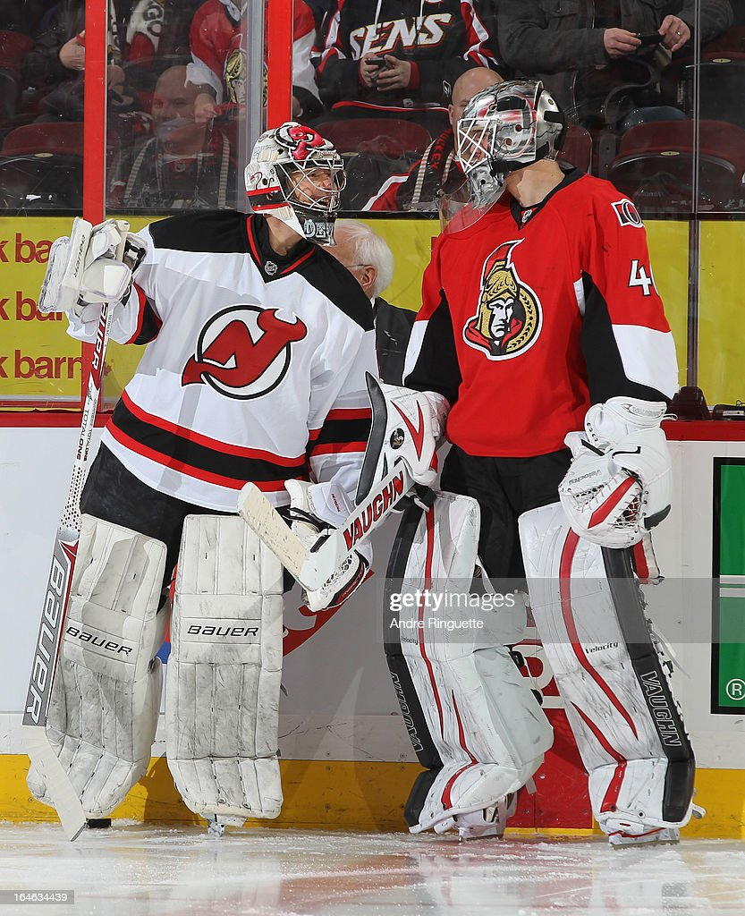 Robin Lehner of the Ottawa Senators chats with Johan Hedberg of the New Jersey Devils during warmup prior to an NHL game on March 25 2013 at...