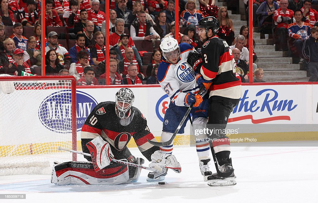 <a gi-track='captionPersonalityLinkClicked' href=/galleries/search?phrase=Robin+Lehner&family=editorial&specificpeople=5894610 ng-click='$event.stopPropagation()'>Robin Lehner</a> #40 of the Ottawa Senators covers the puck as <a gi-track='captionPersonalityLinkClicked' href=/galleries/search?phrase=Jared+Cowen&family=editorial&specificpeople=4594191 ng-click='$event.stopPropagation()'>Jared Cowen</a> #2 defends against <a gi-track='captionPersonalityLinkClicked' href=/galleries/search?phrase=David+Perron&family=editorial&specificpeople=4282591 ng-click='$event.stopPropagation()'>David Perron</a> #57 of the Edmonton Oilers during an NHL game at Canadian Tire Centre on October 19, 2012 in Ottawa, Ontario, Canada.