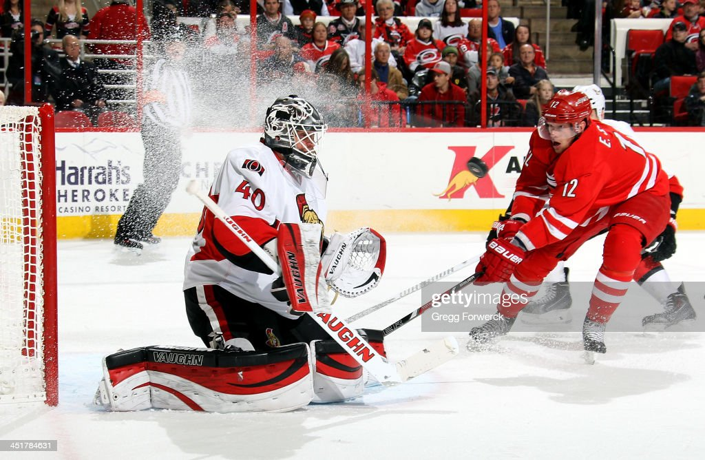 <a gi-track='captionPersonalityLinkClicked' href=/galleries/search?phrase=Robin+Lehner&family=editorial&specificpeople=5894610 ng-click='$event.stopPropagation()'>Robin Lehner</a> #40 of the Ottawa Senators eyes a shot as <a gi-track='captionPersonalityLinkClicked' href=/galleries/search?phrase=Eric+Staal&family=editorial&specificpeople=202199 ng-click='$event.stopPropagation()'>Eric Staal</a> #12 of the Carolina Hurricanes skates hard to the net during their NHL game at PNC Arena on November 24, 2013 in Raleigh, North Carolina.