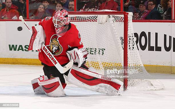 Robin Lehner of the Ottawa Senators makes a save against the Carolina Hurricanes at Canadian Tire Centre on February 16 2015 in Ottawa Ontario Canada