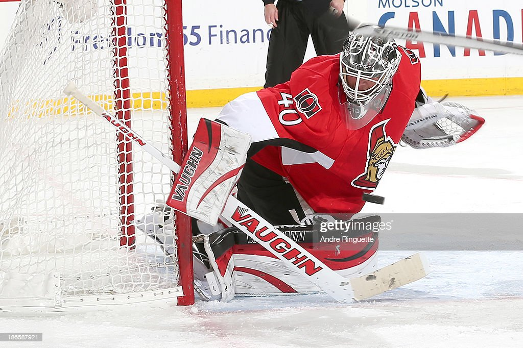 <a gi-track='captionPersonalityLinkClicked' href=/galleries/search?phrase=Robin+Lehner&family=editorial&specificpeople=5894610 ng-click='$event.stopPropagation()'>Robin Lehner</a> #40 of the Ottawa Senators makes a save against the New York Islanders at Canadian Tire Centre on November 1, 2013 in Ottawa, Ontario, Canada.