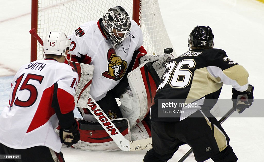 Robin Lehner #40 of the Ottawa Senators makes a save on a shot by Jussi Jokinen #36 of the Pittsburgh Penguins during the game at Consol Energy Center on April 13, 2014 in Pittsburgh, Pennsylvania. The Senators defeated the Penguins 3-2 in a shootout.