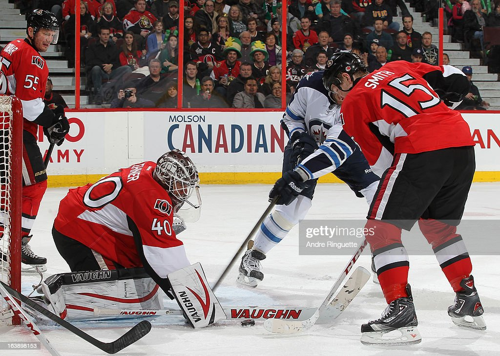 Robin Lehner #40 of the Ottawa Senators makes a stick save against the Winnipeg Jets as teammate Zack Smith #15 looks to clear the rebound on March 17, 2013 at Scotiabank Place in Ottawa, Ontario, Canada.