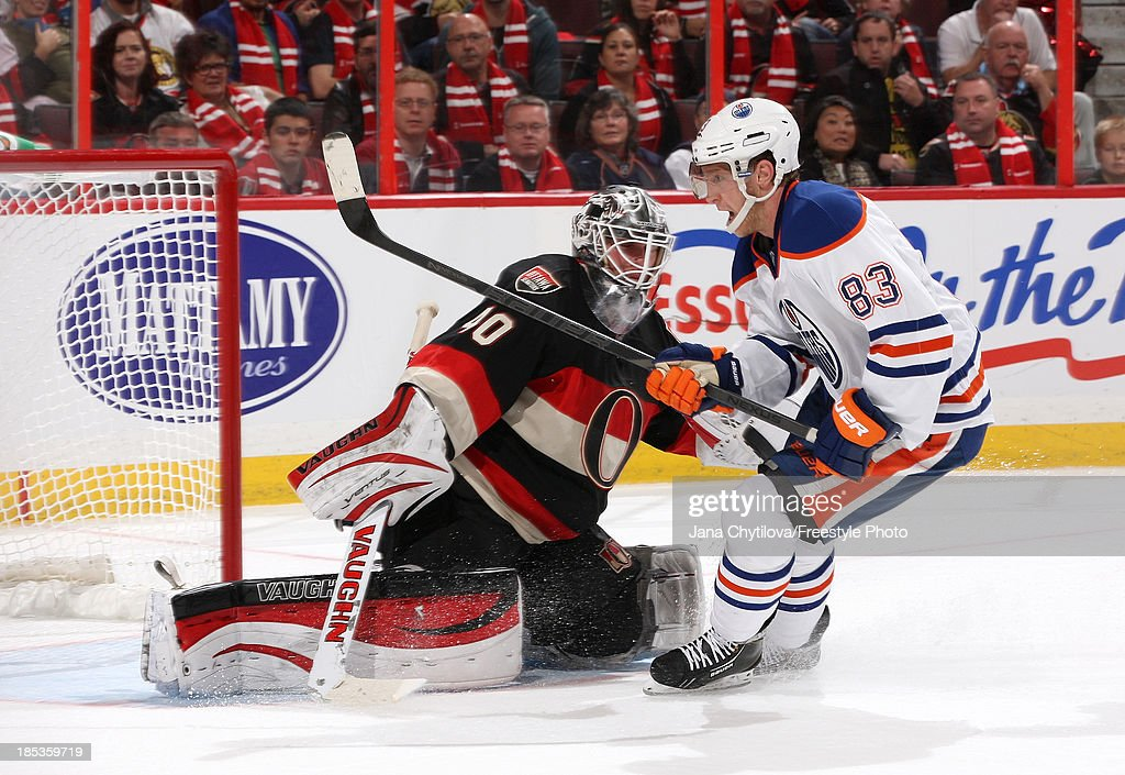 <a gi-track='captionPersonalityLinkClicked' href=/galleries/search?phrase=Robin+Lehner&family=editorial&specificpeople=5894610 ng-click='$event.stopPropagation()'>Robin Lehner</a> #40 of the Ottawa Senators makes against <a gi-track='captionPersonalityLinkClicked' href=/galleries/search?phrase=Ales+Hemsky&family=editorial&specificpeople=202828 ng-click='$event.stopPropagation()'>Ales Hemsky</a> #83 of the Edmonton Oilers during an NHL game at Canadian Tire Centre on October 19, 2012 in Ottawa, Ontario, Canada.