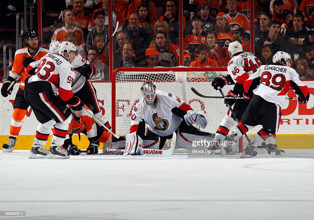 <a gi-track='captionPersonalityLinkClicked' href=/galleries/search?phrase=Robin+Lehner&family=editorial&specificpeople=5894610 ng-click='$event.stopPropagation()'>Robin Lehner</a> #40 of the Ottawa Senators makes the save late in the third period against the Philadelphia Flyers at the Wells Fargo Center on April 11, 2013 in Philadelphia, Pennsylvania. The Senators defeated the Flyers 3-1.