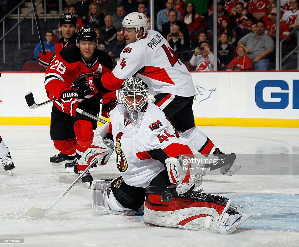 <a gi-track='captionPersonalityLinkClicked' href=/galleries/search?phrase=Robin+Lehner&family=editorial&specificpeople=5894610 ng-click='$event.stopPropagation()'>Robin Lehner</a> #40 of the Ottawa Senators makes the second period save as <a gi-track='captionPersonalityLinkClicked' href=/galleries/search?phrase=Patrik+Elias&family=editorial&specificpeople=201827 ng-click='$event.stopPropagation()'>Patrik Elias</a> #26 of the New Jersey Devils looks for the rebound at the Prudential Center on December 18, 2013 in Newark, New Jersey.