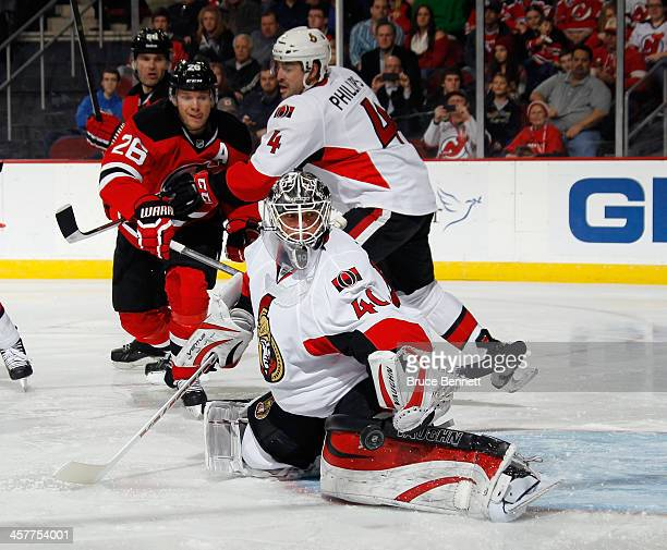 Robin Lehner of the Ottawa Senators makes the second period save as Patrik Elias of the New Jersey Devils looks for the rebound at the Prudential...