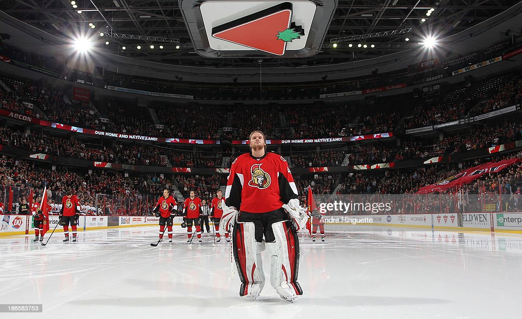Robin Lehner #40 of the Ottawa Senators stands at attention during the singing of the national anthems prior to starting a game against the New York Islanders at Canadian Tire Centre on November 1, 2013 in Ottawa, Ontario, Canada.