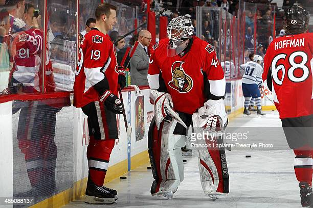 Robin Lehner of the Ottawa Senators talks with Jason Spezza during warmup prior to their game against the Toronto Maple Leafs on April 12 2014 at...