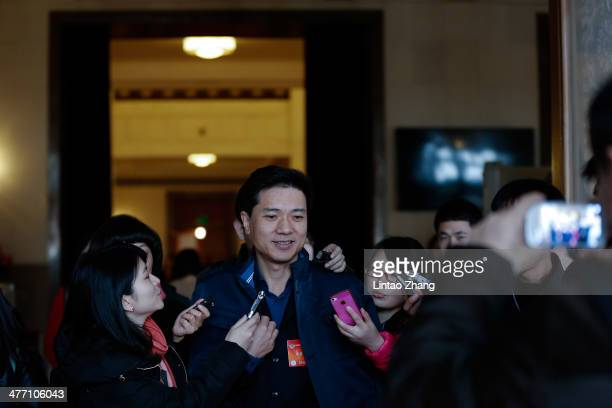 Robin Li chairman and chief executive officer of Baidu Inc speaks to reporters during the third day of China's National People's Congress on March...
