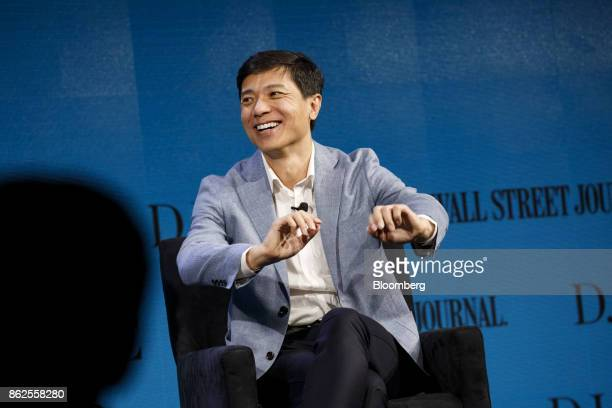 Robin Li chief executive officer of Baidu Inc smiles during the Wall Street Journal DLive global technology conference in Laguna Beach California US...