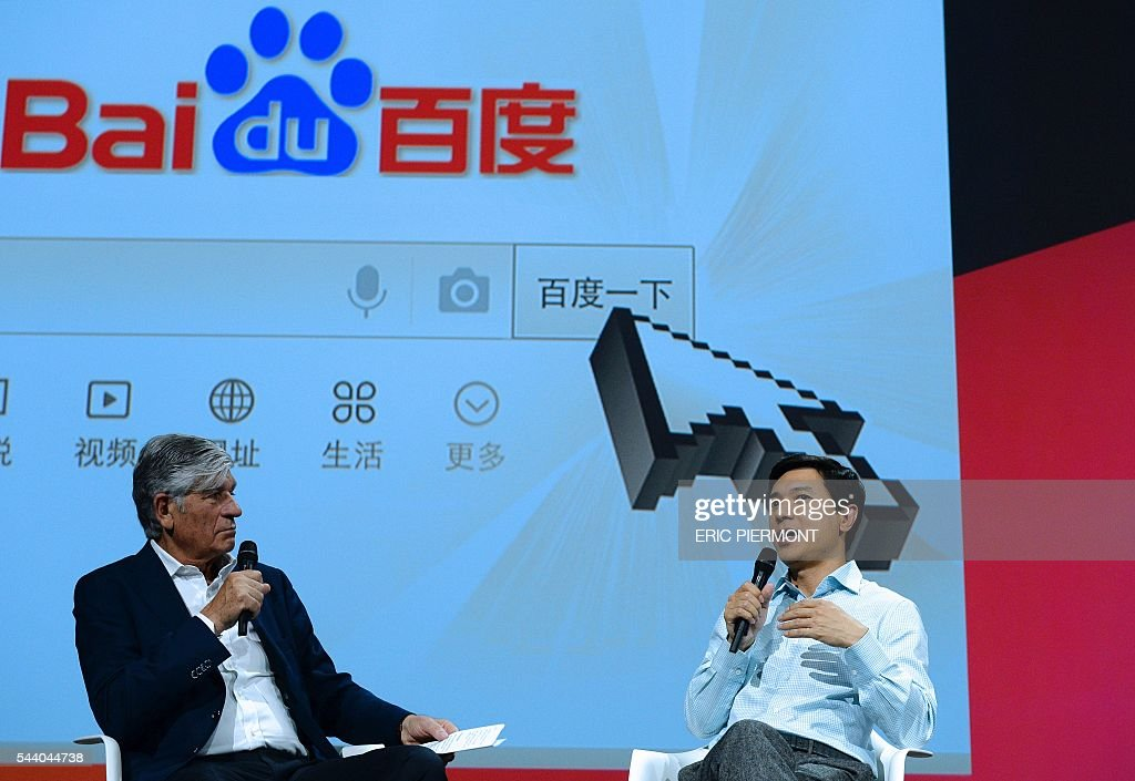 Robin Li (R), founder, Chairman and CEO of Baidu talks as Publicis Group Cairman and CEO Maurice Levy listens while attending a session at the Viva technology event in Paris on July 1st, 2016. / AFP / ERIC
