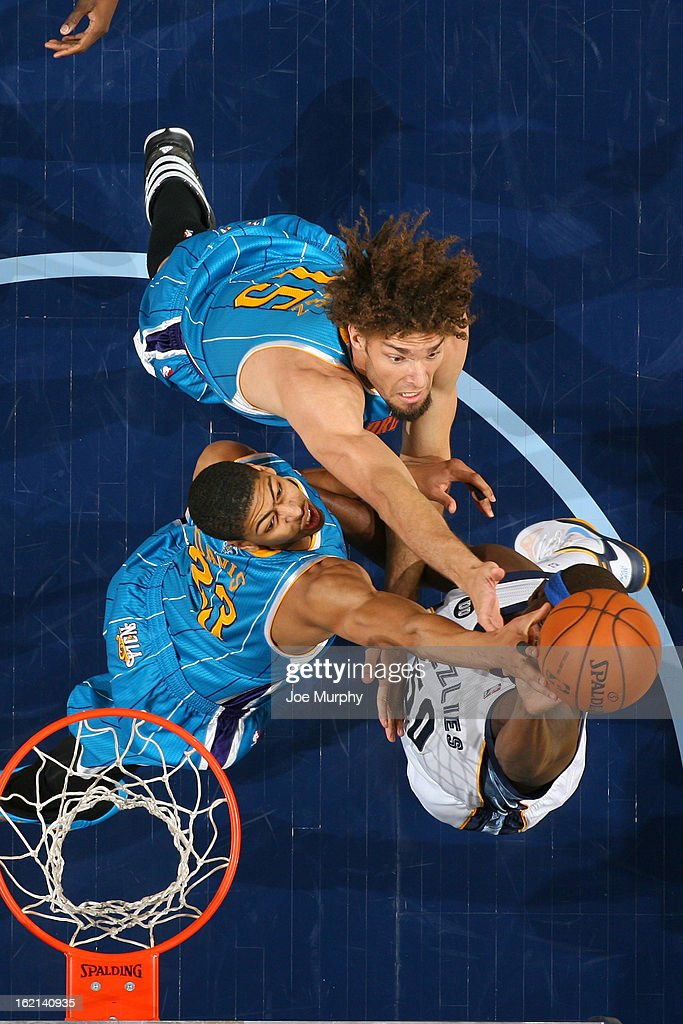 <a gi-track='captionPersonalityLinkClicked' href=/galleries/search?phrase=Robin+Lopez&family=editorial&specificpeople=2351509 ng-click='$event.stopPropagation()'>Robin Lopez</a> #15 and Anthony Davis #23 of the New Orleans Hornets fights for the rebound against the <a gi-track='captionPersonalityLinkClicked' href=/galleries/search?phrase=Zach+Randolph&family=editorial&specificpeople=201595 ng-click='$event.stopPropagation()'>Zach Randolph</a> #50 of the Memphis Grizzlies on January 27, 2013 at FedExForum in Memphis, Tennessee.