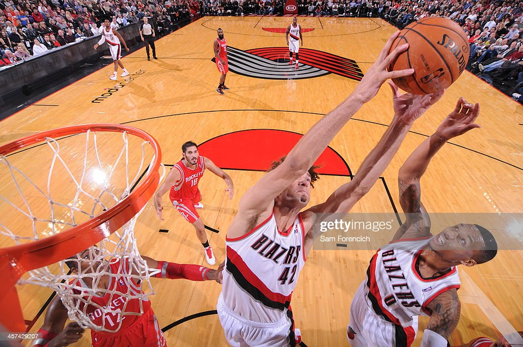 <a gi-track='captionPersonalityLinkClicked' href=/galleries/search?phrase=Robin+Lopez&family=editorial&specificpeople=2351509 ng-click='$event.stopPropagation()'>Robin Lopez</a> #42 and <a gi-track='captionPersonalityLinkClicked' href=/galleries/search?phrase=Damian+Lillard&family=editorial&specificpeople=6598327 ng-click='$event.stopPropagation()'>Damian Lillard</a> #0 of the Portland Trail Blazers go up for a rebound against the Houston Rockets on November 5, 2013 at the Moda Center Arena in Portland, Oregon.
