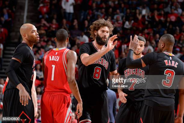 Robin Lopez and Dwyane Wade of the Chicago Bulls high five during the game against the Houston Rockets on February 3 2017 at the Toyota Center in...