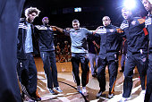 Robin Lopez Hakim Warrick Ronnie Price Shannon Brown and Jared Dudley of the Phoenix Suns huddle up before the NBA game against the New Jersey Nets...