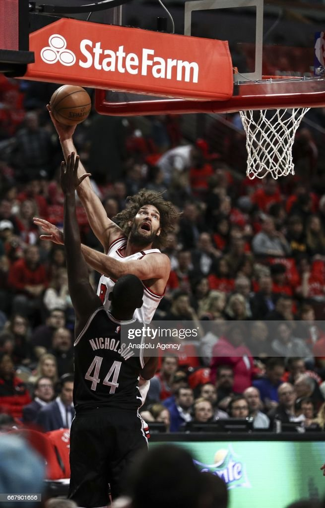 Robin Lopez (rear) of Chicago Bulls in action during the NBA game between Chicago Bulls and Brooklyn Nets at United Center in Chicago, United States on April 12, 2017.