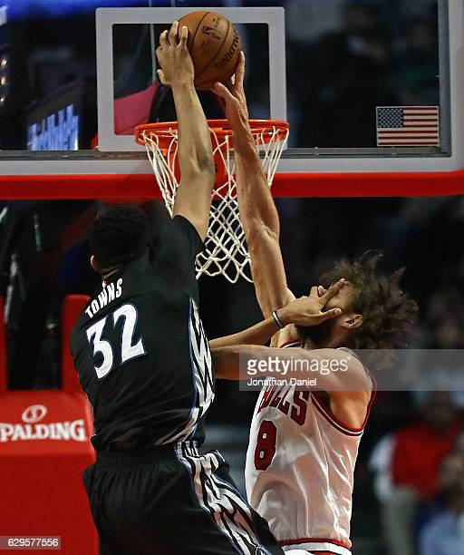Robin Lopez of the Chicago Bulls blocks a shot by KarlAnthony Towns of the Minnesota Timberwolves despite getting a hand in his face at the United...