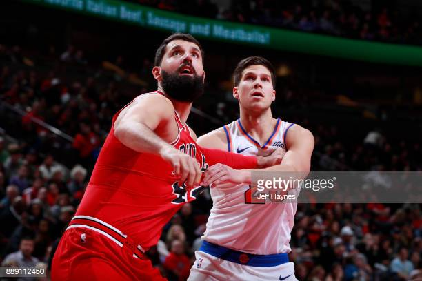 Robin Lopez of the Chicago Bulls boxes out against Doug McDermott of the New York Knicks on December 9 2017 at the United Center in Chicago Illinois...
