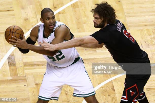 Robin Lopez of the Chicago Bulls defends Al Horford of the Boston Celtics during the fourth quarter of Game One of the Eastern Conference...