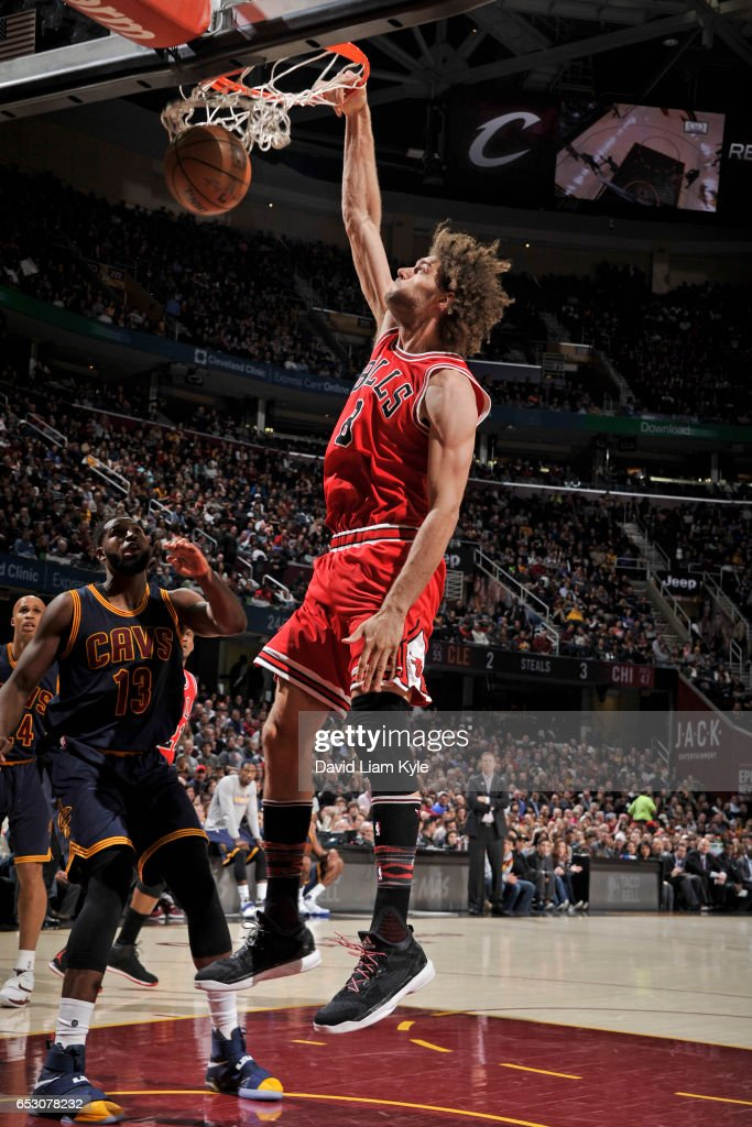 Robin Lopez #8 of the Chicago Bulls dunks against the Cleveland Cavaliers on February 25, 2017 at Quicken Loans Arena in Cleveland, Ohio.